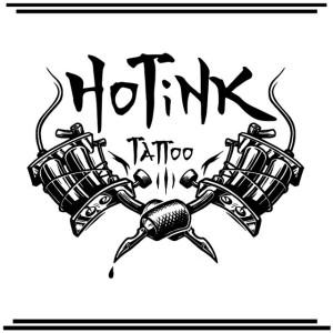 Tattoo studio emblem with machines and skull